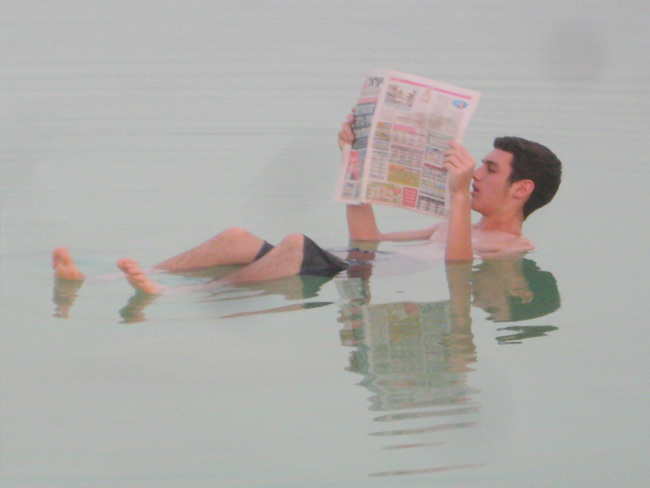 Catching up on the news while floating on the Dead Sea