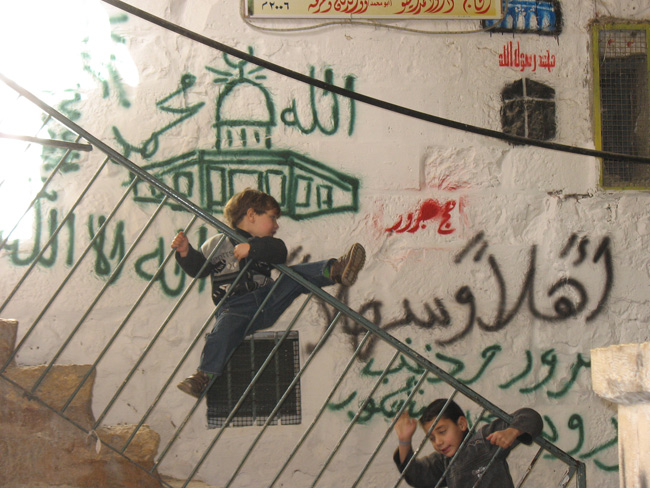 Graffiti announcing someone's Haj (pilgramage) to Mecca